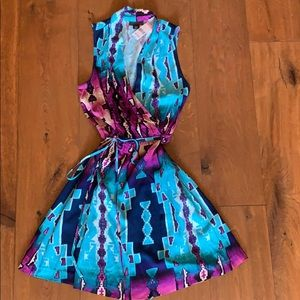 Faux wrap dress with Western/Aztec print. Colorful